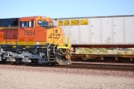 Close up view of the crew cab of BNSF 7854 as she rolls past me into a rising sun in this early am shot.